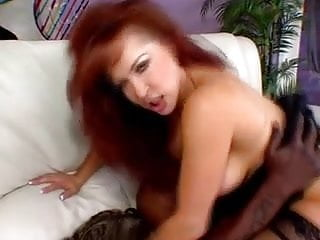 Busty Redhead In Interracial Action